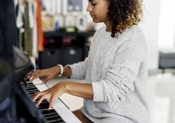woman-playing-on-a-piano